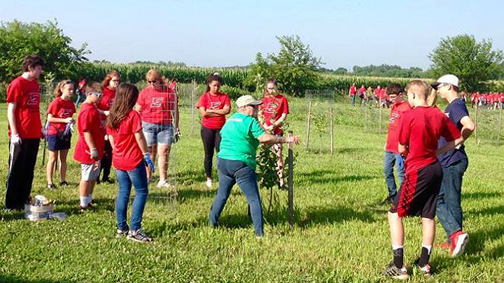 This is a picture of an adult Silverwood Park volunteer with Edgerton High School volunteers.