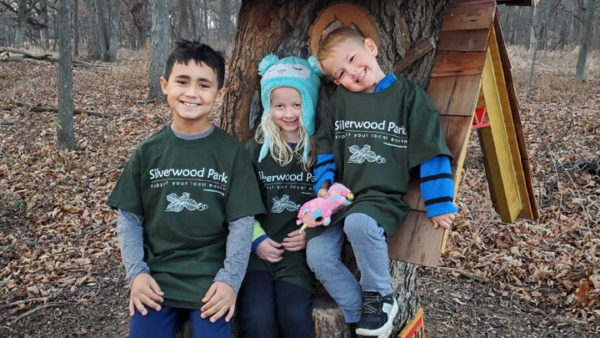 This is a picture of three children with Silverwood Park t-shirts.