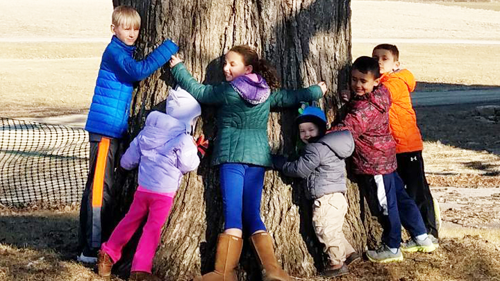 This is a picture of children at Silverwood's Great Oak on Arbor Day 2018.