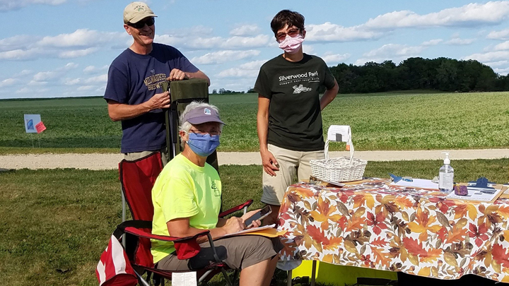 This is a picture of three Silverwood Park volunteers at a public event.
