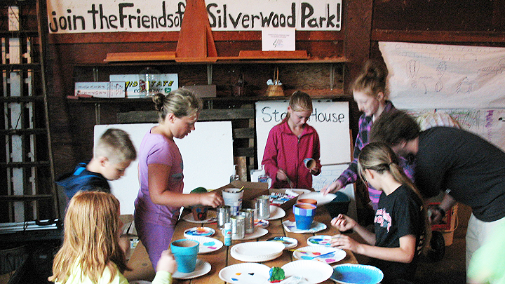 This is a picture of 2015 Edgerton School District summer school students in a painting project.