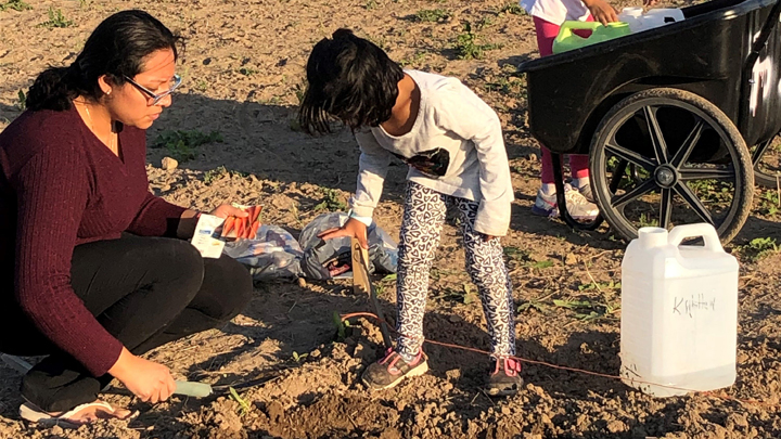 This is a picture of a mother and daughter doing family gardening at Silverwood Park in 2020