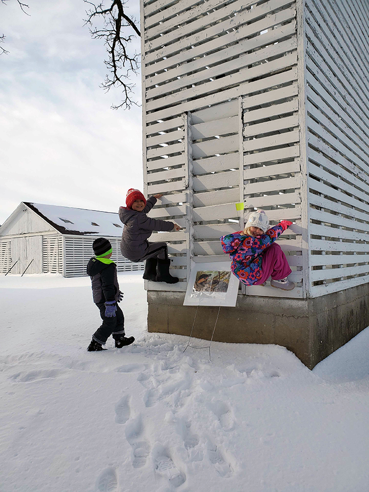 Rita Fox's grandkids climb the corn crib