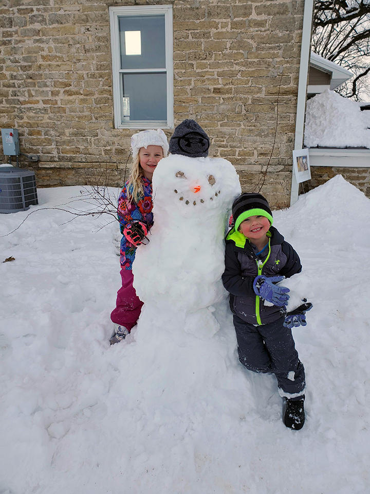 Rita Fox's grandchildren make a snowman