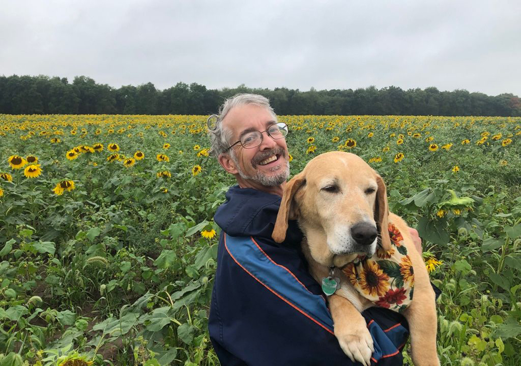 This is a picture of John Peck, and his dog, of Yellow Dog Produce at Silverwood Park